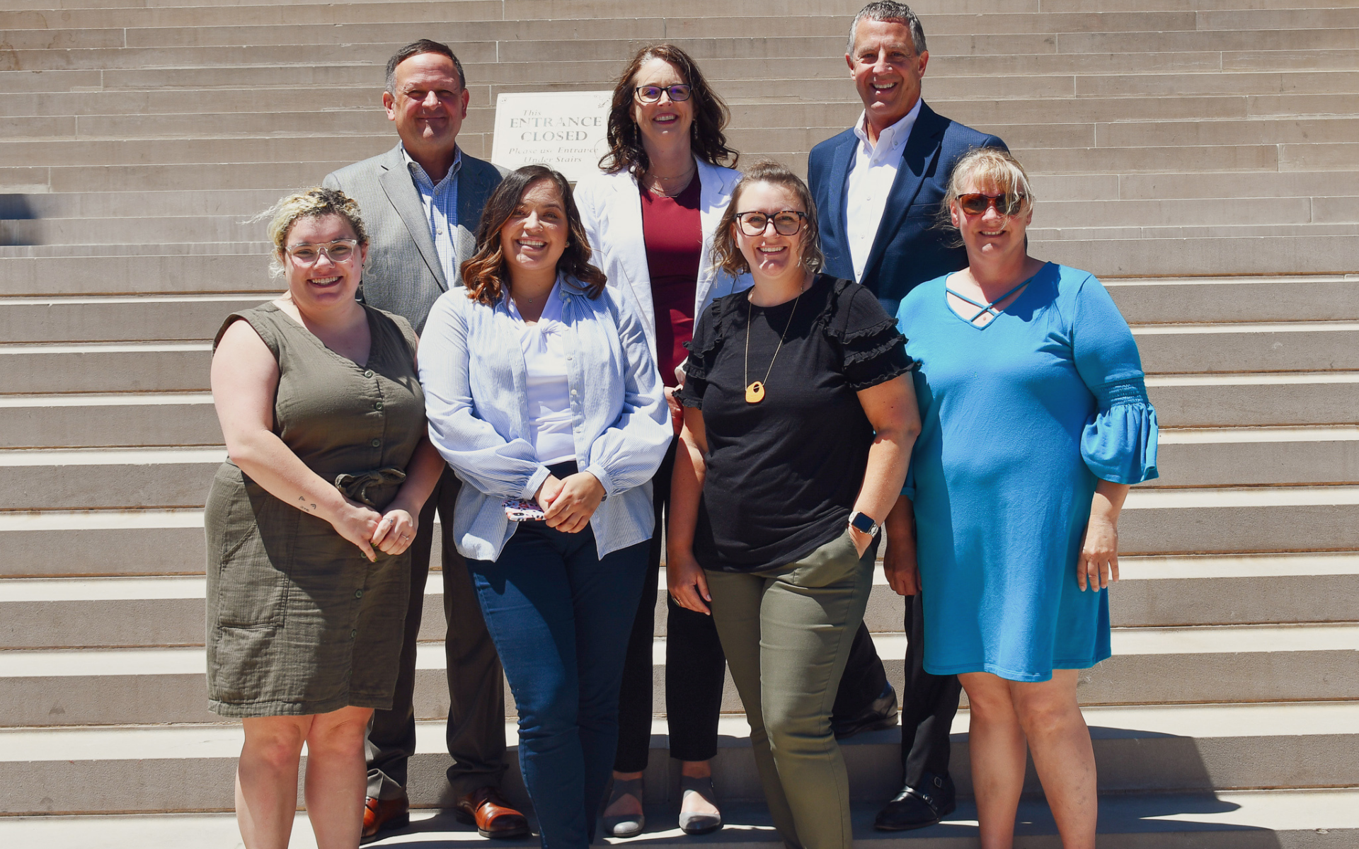 A photo of the MAPSA team standing on the Michigan Capitol steps.