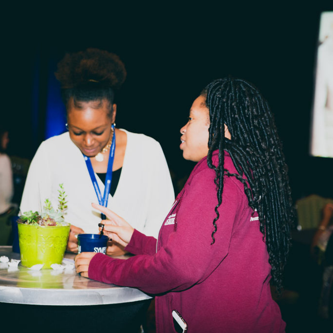 A photo of two ladies at the 2018 Michigan Charter School Symposium Reception.