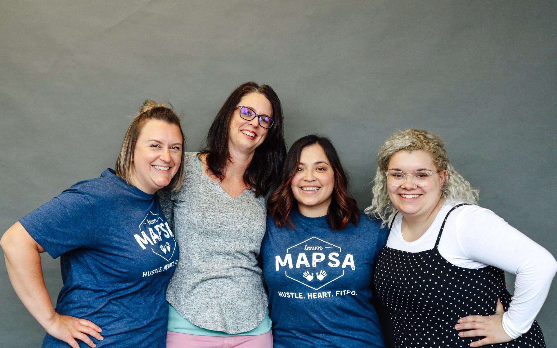 A photo of MAPSA team members Becky Carlton, Heather Risner, Grace Noyola and Vaughn Springer.