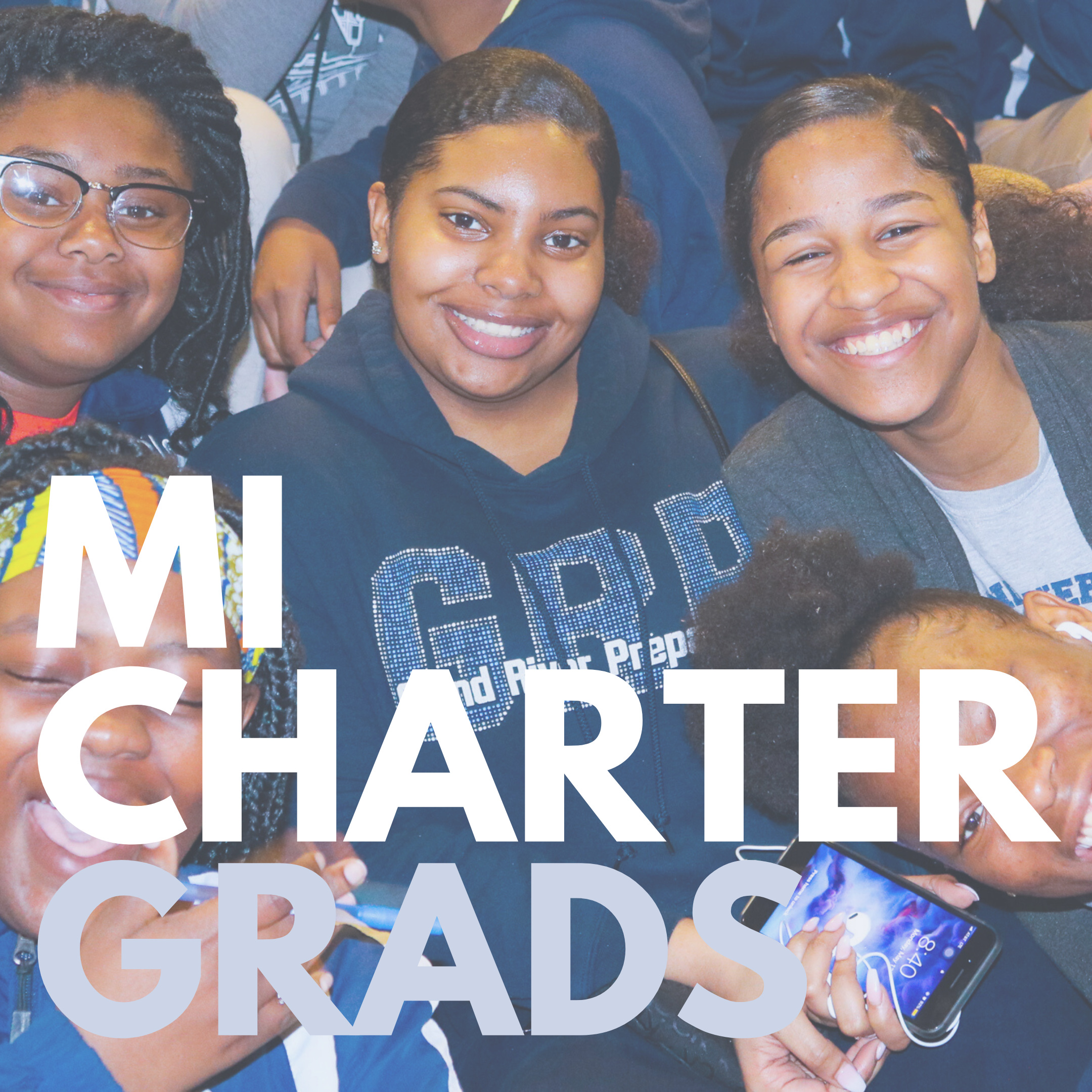 A photo of five black high school charter students, who are sporting their school swag and smiling at the camera.