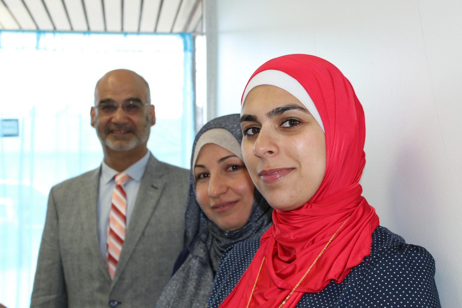 A photo of  (left to right) Central Academy of Ann Arbor principal Luay Shalabi, support staff Nahla Attar, and Parent Coordinator Nadia Hasan.