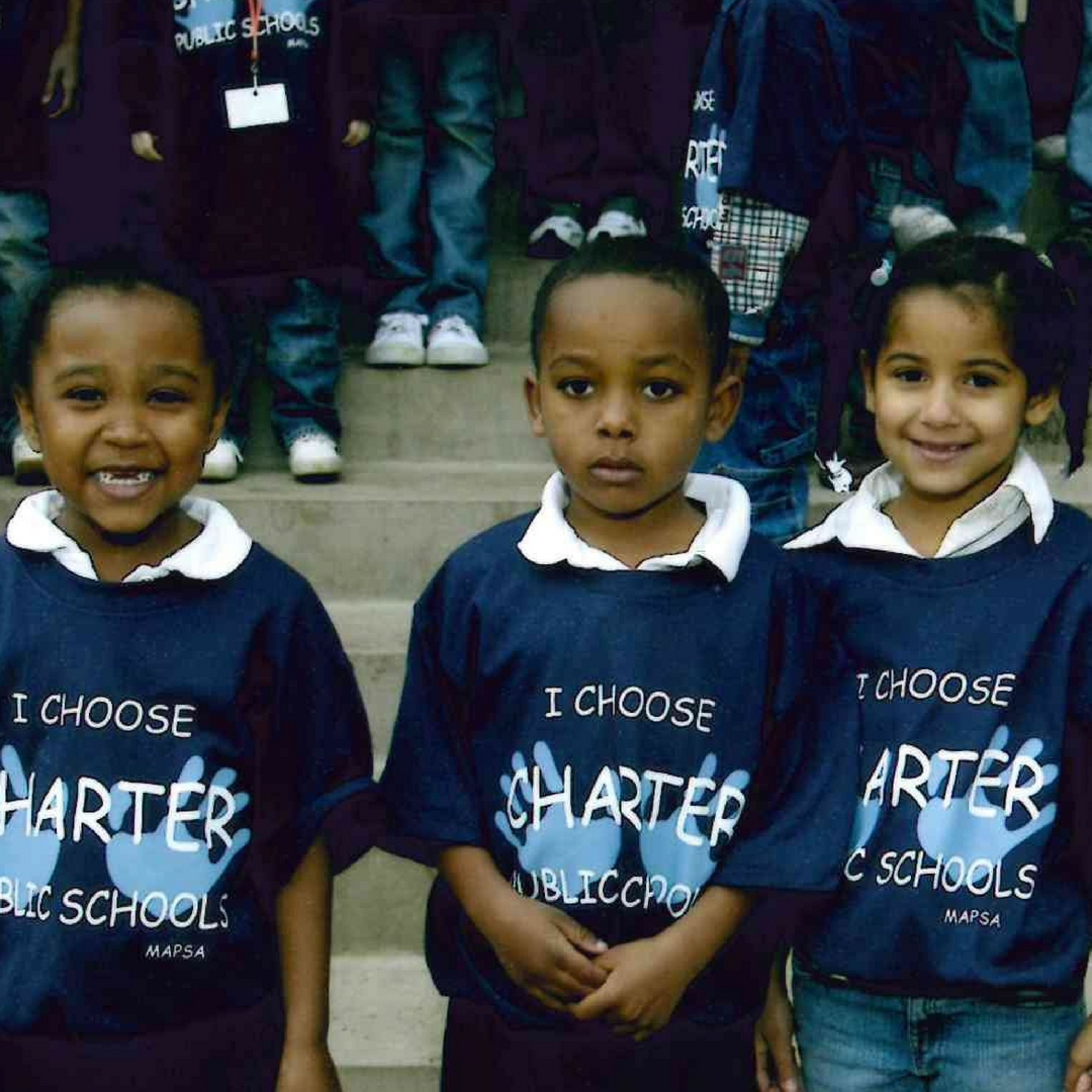 A historic photo of three young charter school female students.