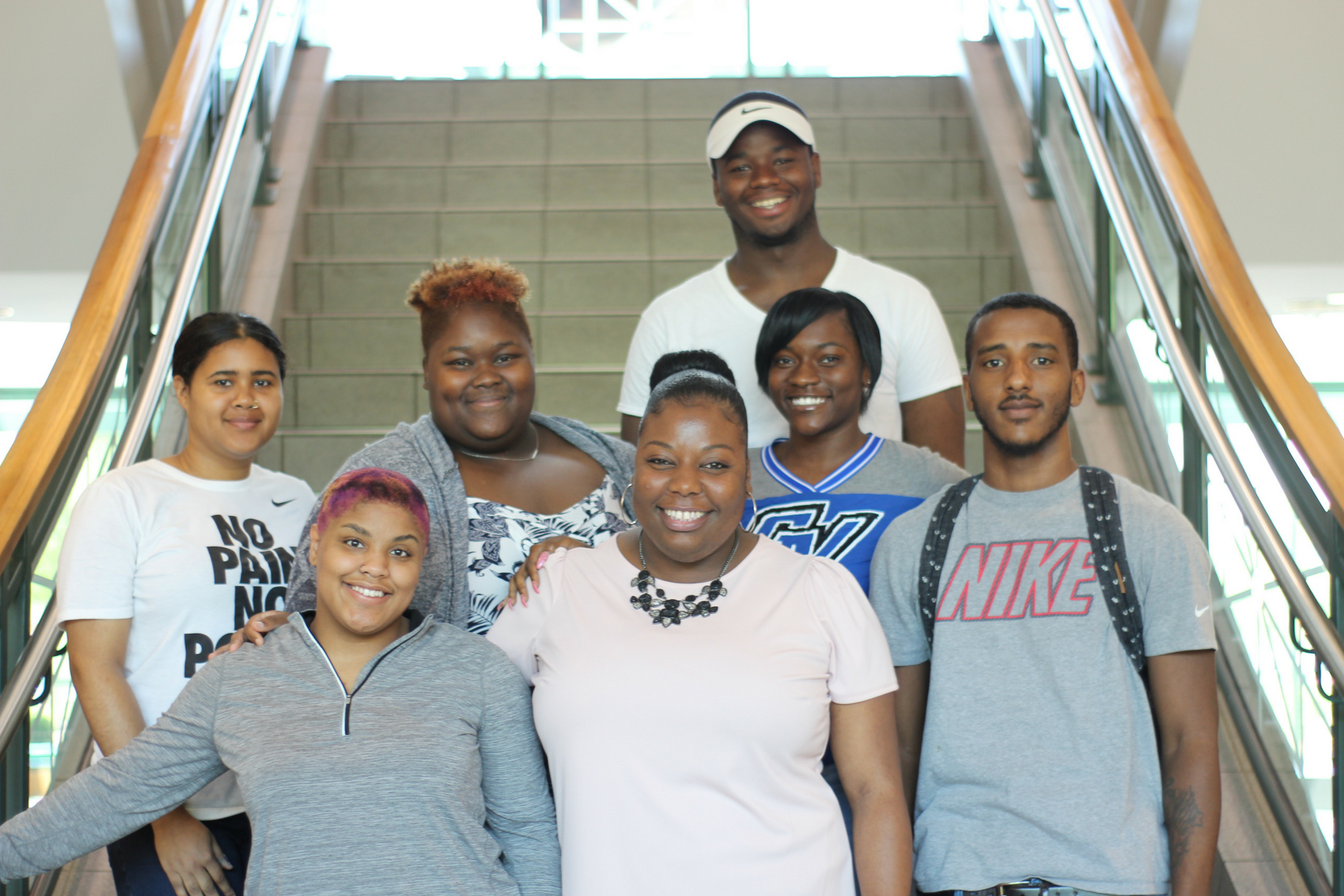 A photo of charter alumna and GVSU Academic Advisor, V'Lecea Hunter (center), surrounded by students she has mentored.