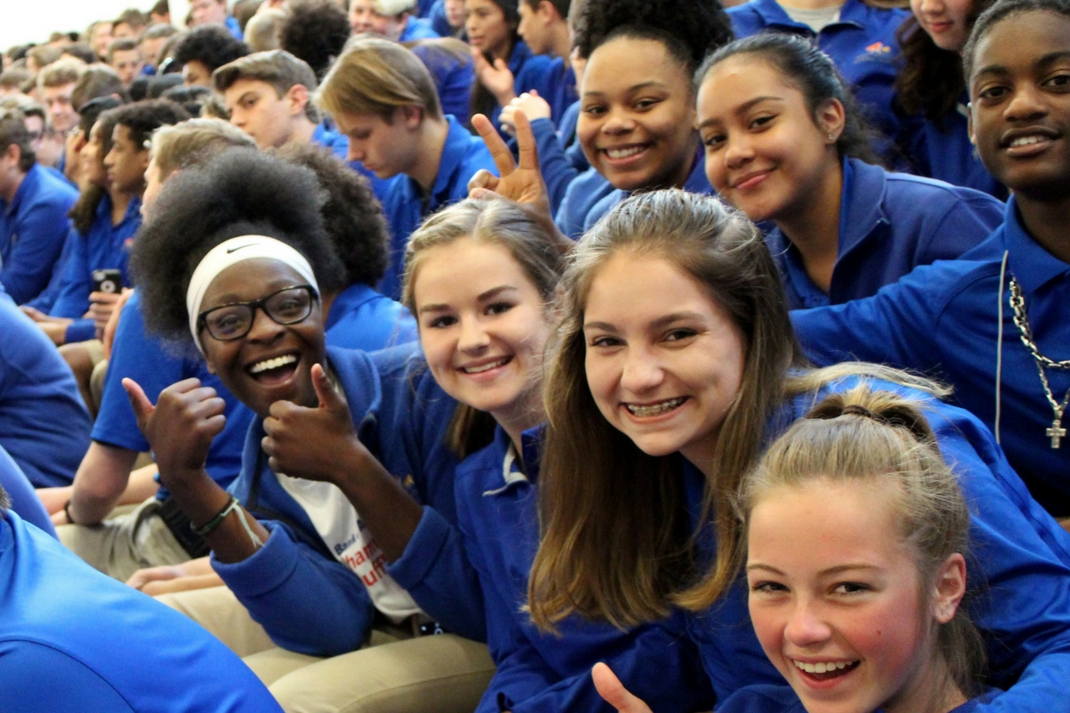 A photo of students from West Michigan Aviation Academy during a school assembly.