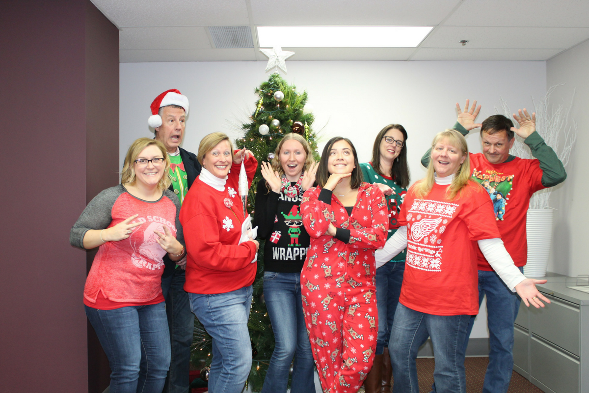 A photo of the MAPSA staff during a holiday celebration.
