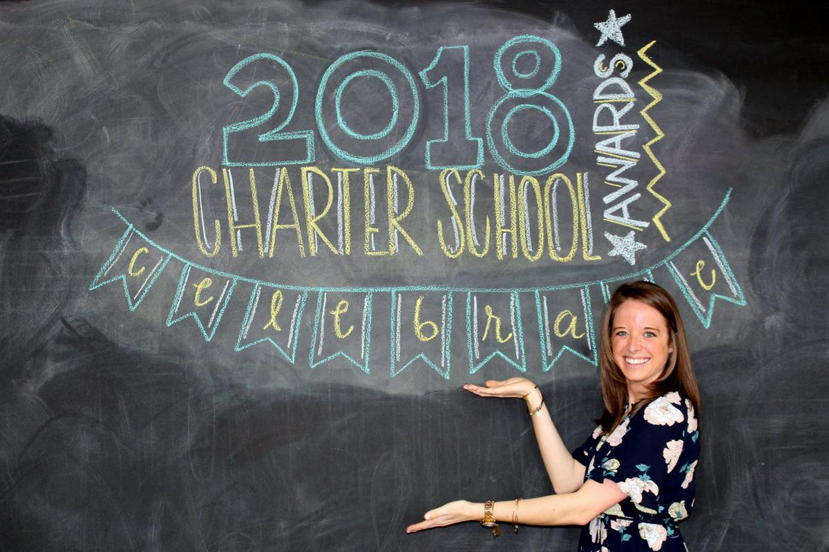 A photo of 2018 Charter School Teacher of the Year Award Finalist, Jennifer Villwock, in front of a chalkboard.