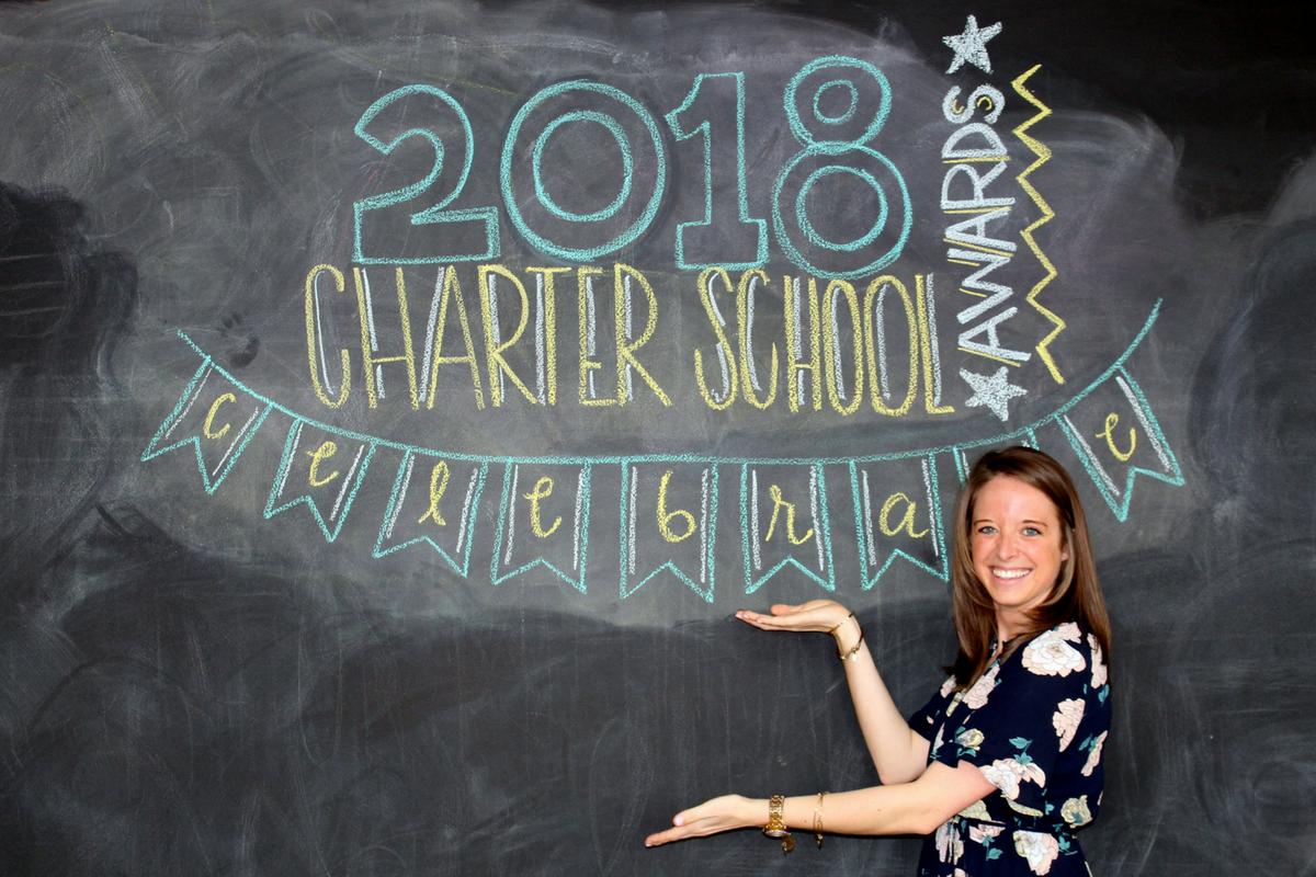 A photo of 2018 Charter School Teacher of the Year Award Finalist, Jennifer Villwock, in front of a chalkboard.