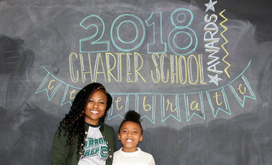 A photo o Aquan Grant, 2018 Charter School Admin of the Year finalist, and her daughter.