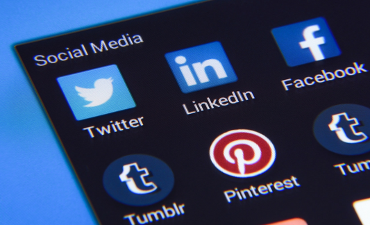 A photo of several social media icons, including Facebook, Twitter, LinkedIn, Tumblr and Pinterest.