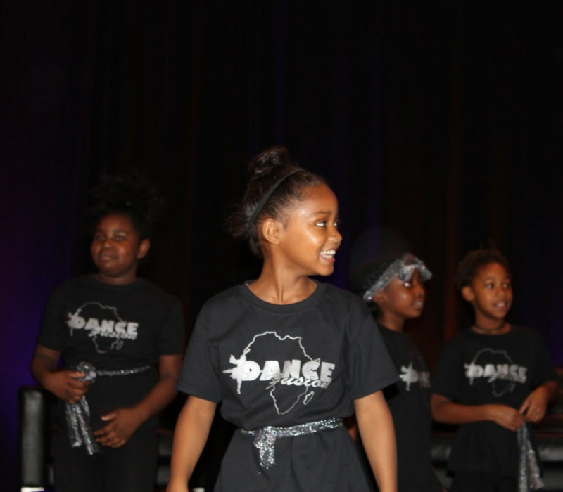 A photo of several female students performing a traditional African dance at MAPSA's 2017 Charter School Symposium.