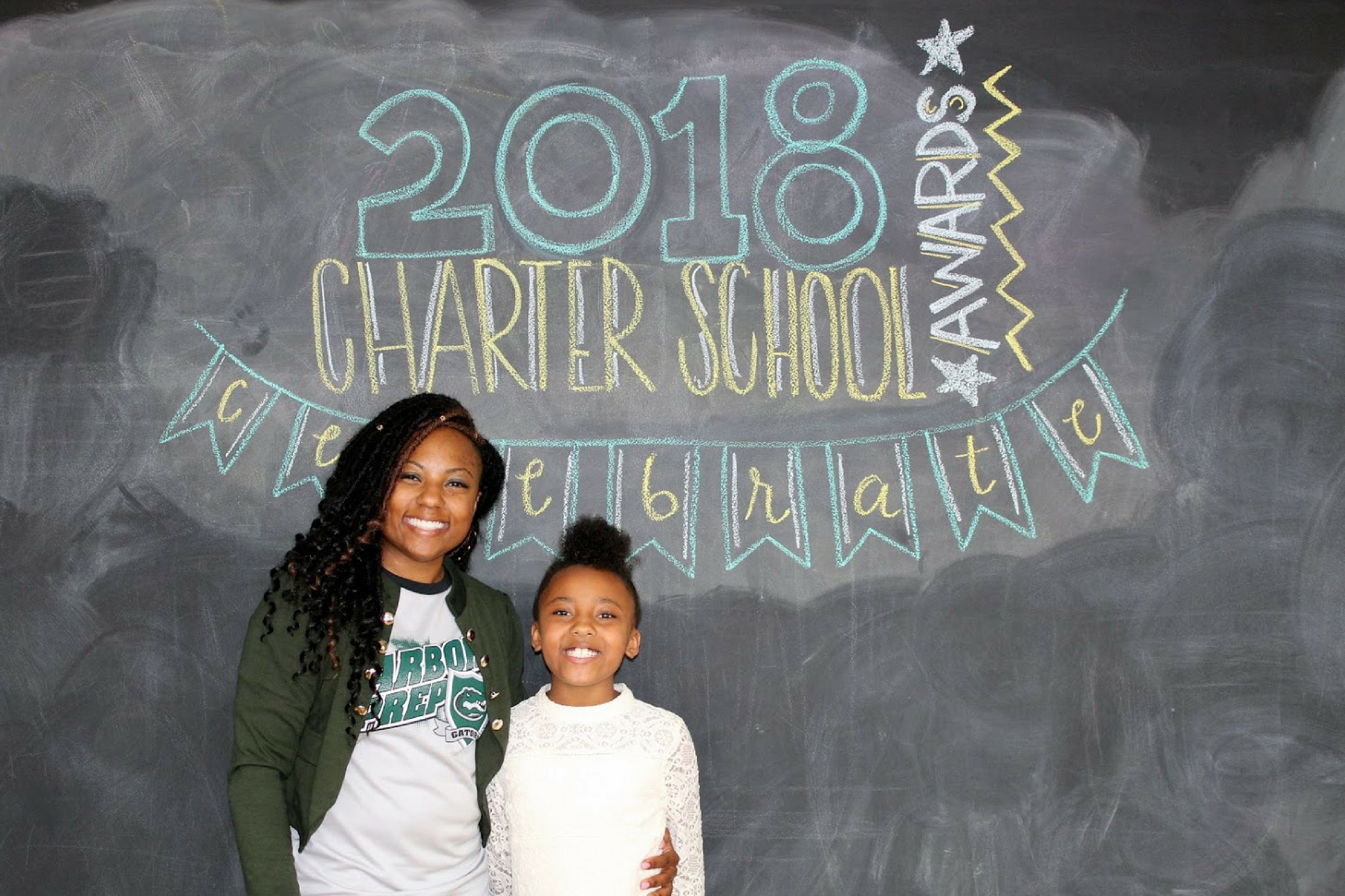 A photo of 2018 Charter School Administrator of the Year finalist, Aquan Grant, with her daughter.
