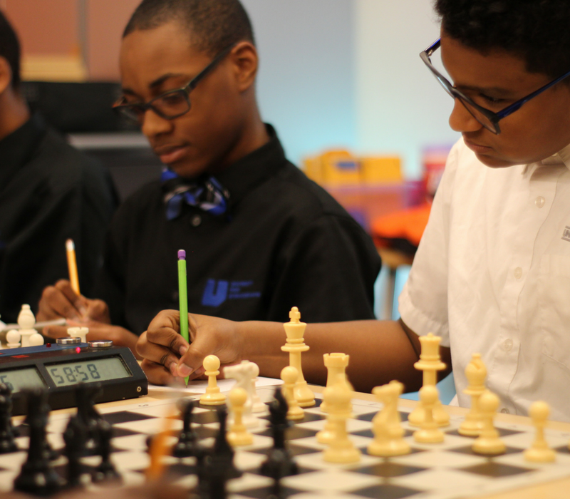 A photo of several students from Detroit's Prep Science & Math Middle School during chess practice.