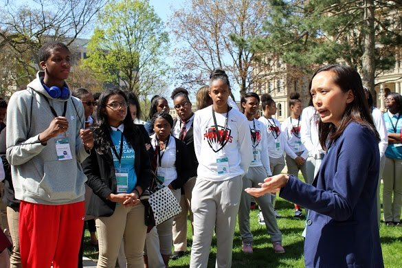 Michigan State Representative, Stephanie Chang, speaks with charter students on the Capitol lawn.