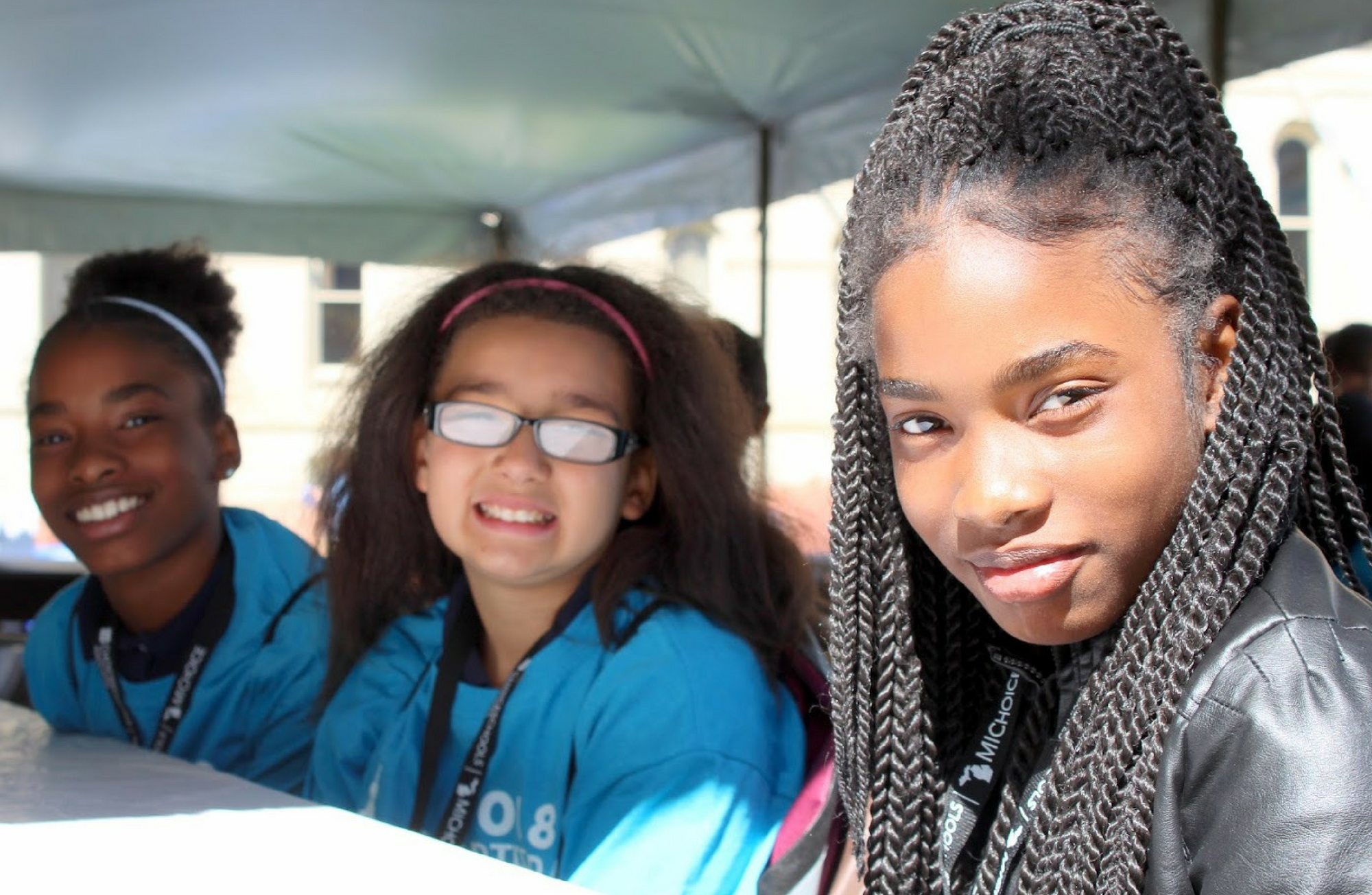 A photo of three girls at the 2018 Charter Day at the Capitol Celebration.
