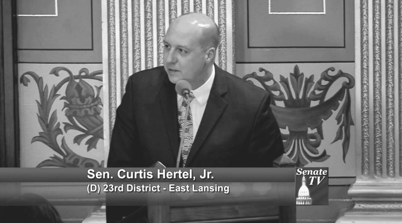 A photo of Michigan State Senator, Curtis Hertel, of District 25.