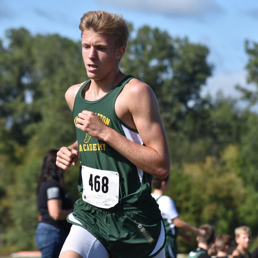 A photo of Gabe Gadwood running cross country.