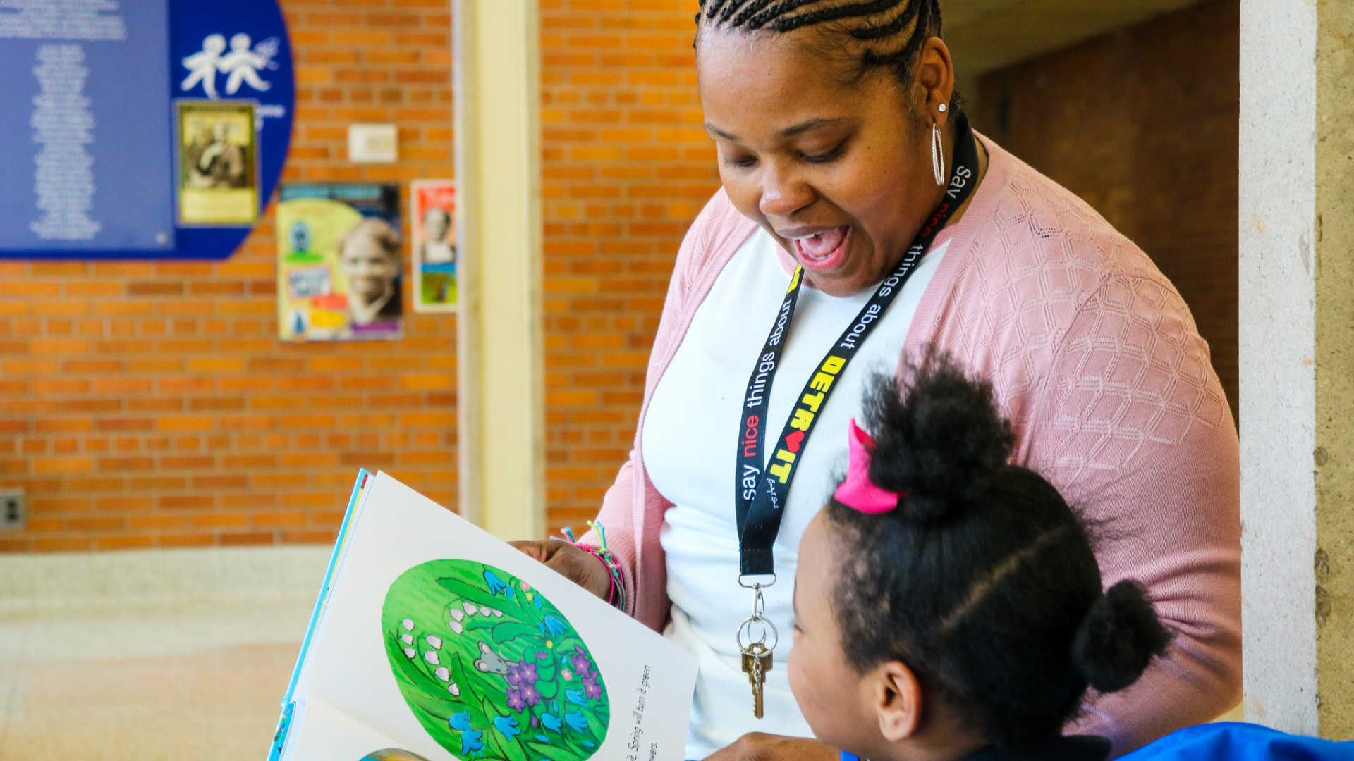 A photo of Distinctive College Prep special education teacher, Chrysantha Norwood, reading to an elementary student.