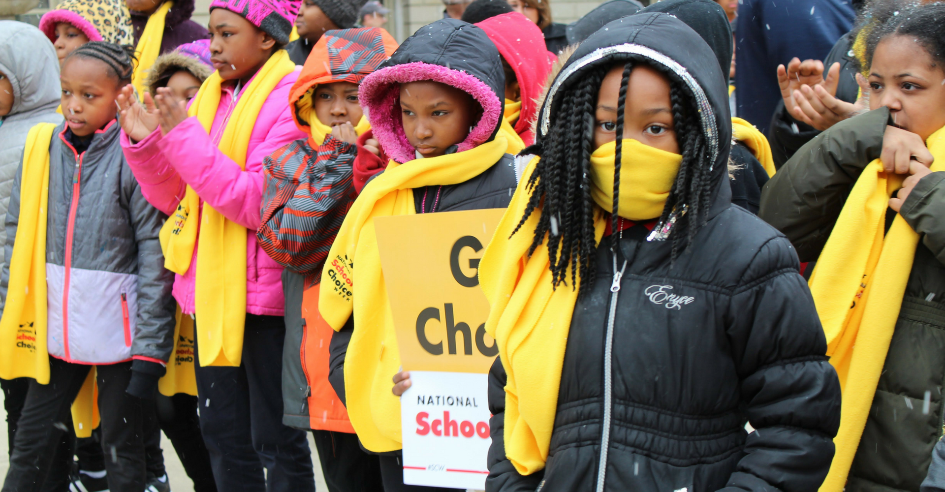 A photo of several students outside the Lansing Capitol building during 2018 National School Choice Week.