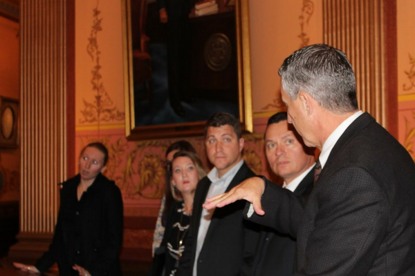 A photo of MAPSA President, Dan Quisenberry, giving a tour of the Lansing Capitol building.