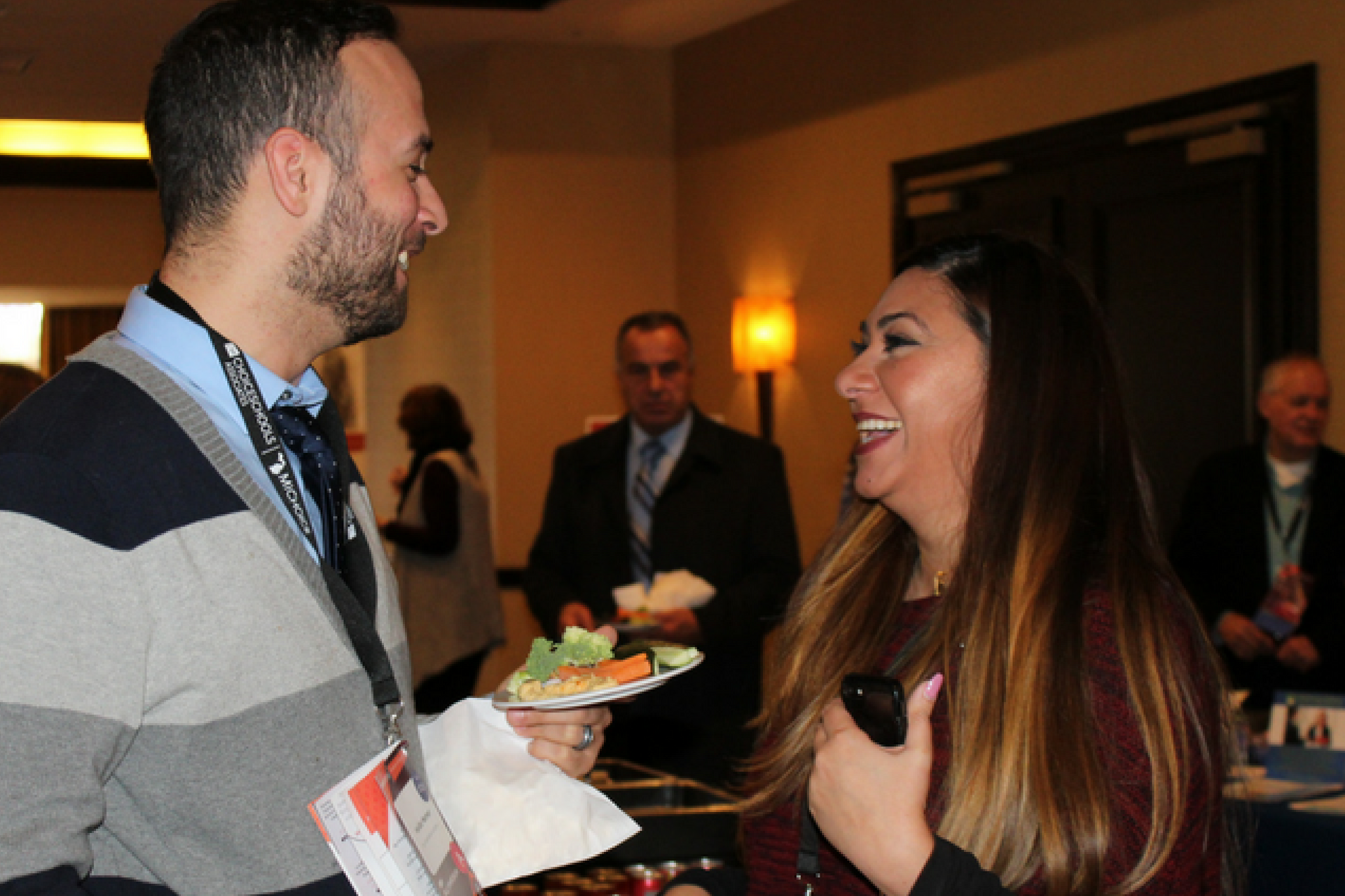 A photo of two charter professionals networking at the 2017 Michigan Charter School Symposium.