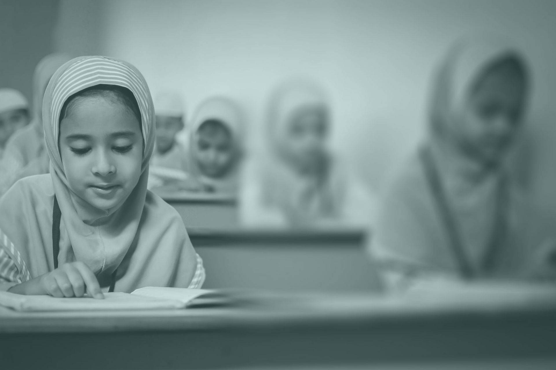 A photo of several female Middle Eastern students in a classroom.